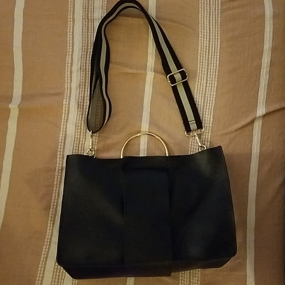 43f0325ae5a9c Black faux leather zara bag w  gold rings handles.  M 5c44d1fc619745d522feca60. Other Bags ...
